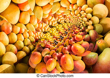 Mango feast - Repeating pattern of a pile of ripe mangos on...