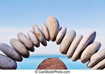 Arch of stones - Stone in the middle of arc of pebbles