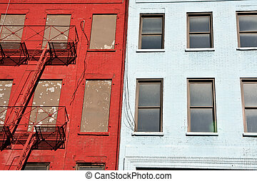 Harlem fire escape - Colorful apartment buildings facades...