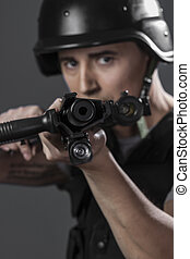 Gunfire, paintball sport player wearing protective helmet...