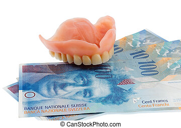 dentition and the swiss franc symbol photo for dentures,...