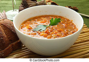 lentil soup - a white bowl of lentil soup with parsley