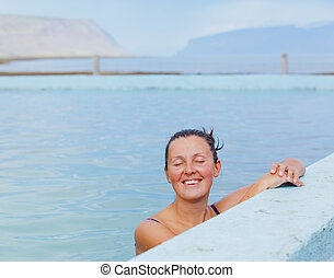 Woman in geothermal spring - Beautiful young woman in wild...
