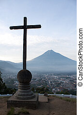 Cross and volcano over Antigua Guatemala valley