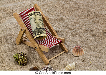 beach chair with piggy bank and dollars - deck chair with...