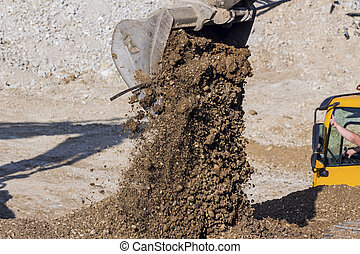 excavator on construction site during earthworks - excavator...