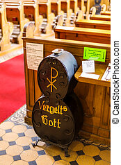 offertory box with inscription in a church