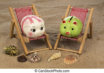 deck chair with piggy bank on the sandy beach symbolic photo...