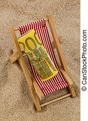 beach chair with euro banknote - a deck chair with a euro...