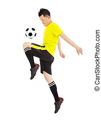 soccer player jumping to stop the ball