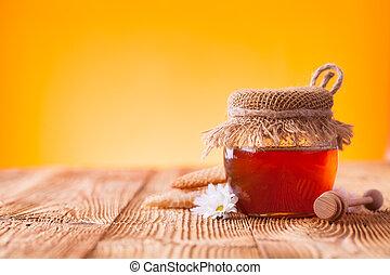 Honey in jar - Still life of honey on wooden table
