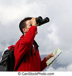 Searching the destination with binoculars in the mountains