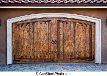Magnificent Carriage Doors - Wooden garage doors on an...