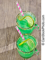 sumer limes drink on old wood