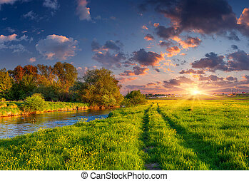 Colorful spring landscape on the siver Dramatic sunset