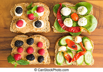 Four healthy open sandwiches for a picnic lunch