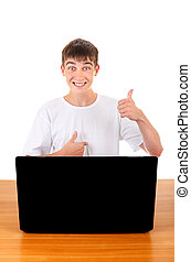 Happy Teenager behind Laptop - Happy Teenager with Badge on...