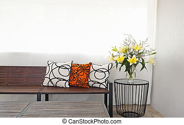 Patio lounge with garden bench and flower decoration
