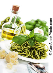 delicious italian pasta with pesto sauce over white