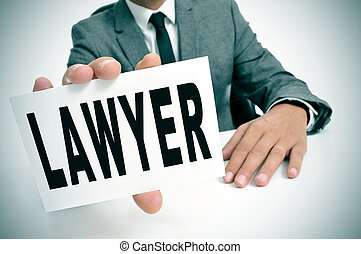 lawyer - a man wearing a suit sitting in a desk holding a...