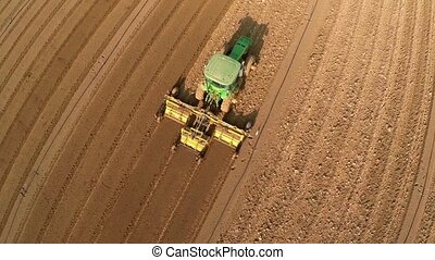 Tractor working the land - Beautiful Aerial view of Tractor...