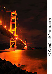 Golden Gate Bridge at Night - Golden Gate bridge spanning...