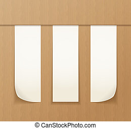 Paper banners on the cardboard background