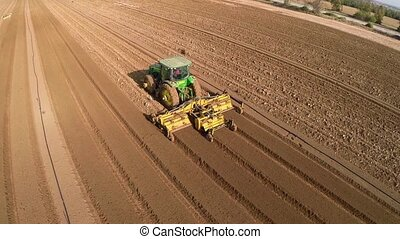 Tractor harvesting the field - Beautiful Aerial view of...