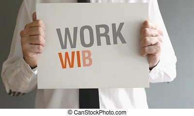 WORK WITH US - Businessman holding paper board with WORK...
