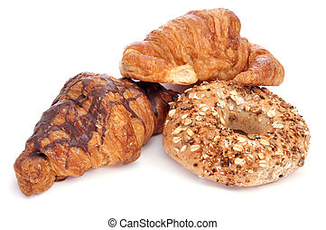 croissants and bagels - some croissants and a bagel on a...