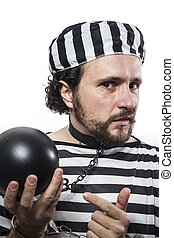 Solution, one caucasian man prisoner criminal with chain ball and handcuffs in studio isolated on white background