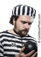Punishment, one caucasian man prisoner criminal with chain ball and handcuffs in studio isolated on white background