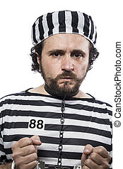 Violence, one caucasian man prisoner criminal with chain ball and handcuffs in studio isolated on white background