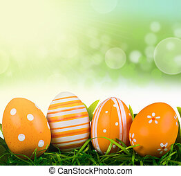 Easter eggs with spring background and lights