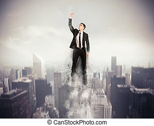 Flying Super hero businessman - Concept of determination and...