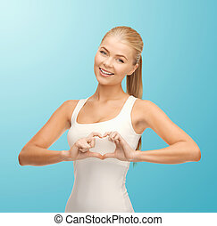 smiling woman showing heart shape gesture - happiness and...