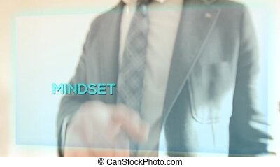 the key to success - a man in suit shows the key to success