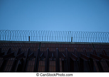 prison fence with blue sky