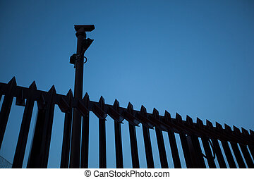 prison fence with cameras