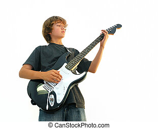 Teen Boy Playing Guitar - Teen boy playing electric guitar...