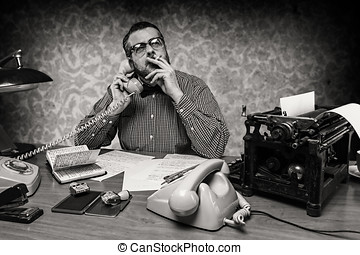 man smoking a cigarette while talking on the phone, 1960s...