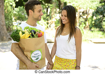 Couple with bag organic vegetables