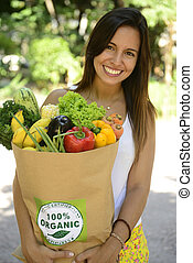Woman with bag organic vegetables