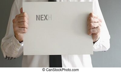 Next big thing ahead - Businessman holding paper board with...