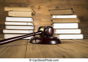 Wooden gavel law books gold scale