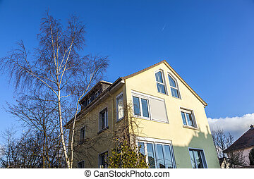 typical one family house under blue sky - typical one family...