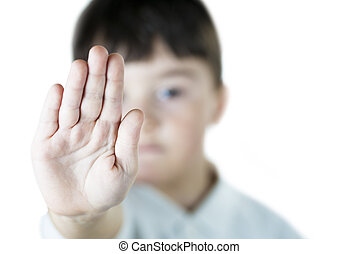 Stop child abuse - A child making s stop gesture with his...