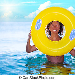 woman with life buoy - Funny woman with life buoy in the...