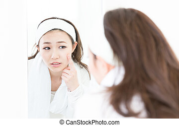 attractive asian woman to see a mirror