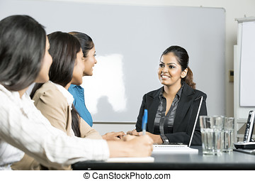 Indian business women in a meeting - Happy Indian business...
